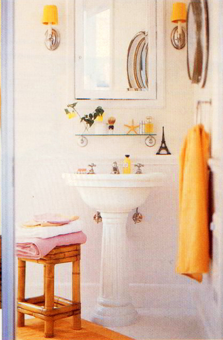White bathroom with orange accents, via #RoomLust